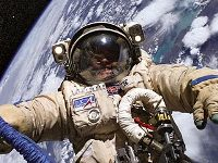 Роскосмос и Space Adventures